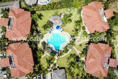 Pool surrounded by apartment buildings Ocean Dream Cabarete