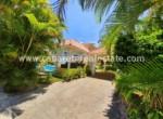 caribbean style house garage beautiful garden