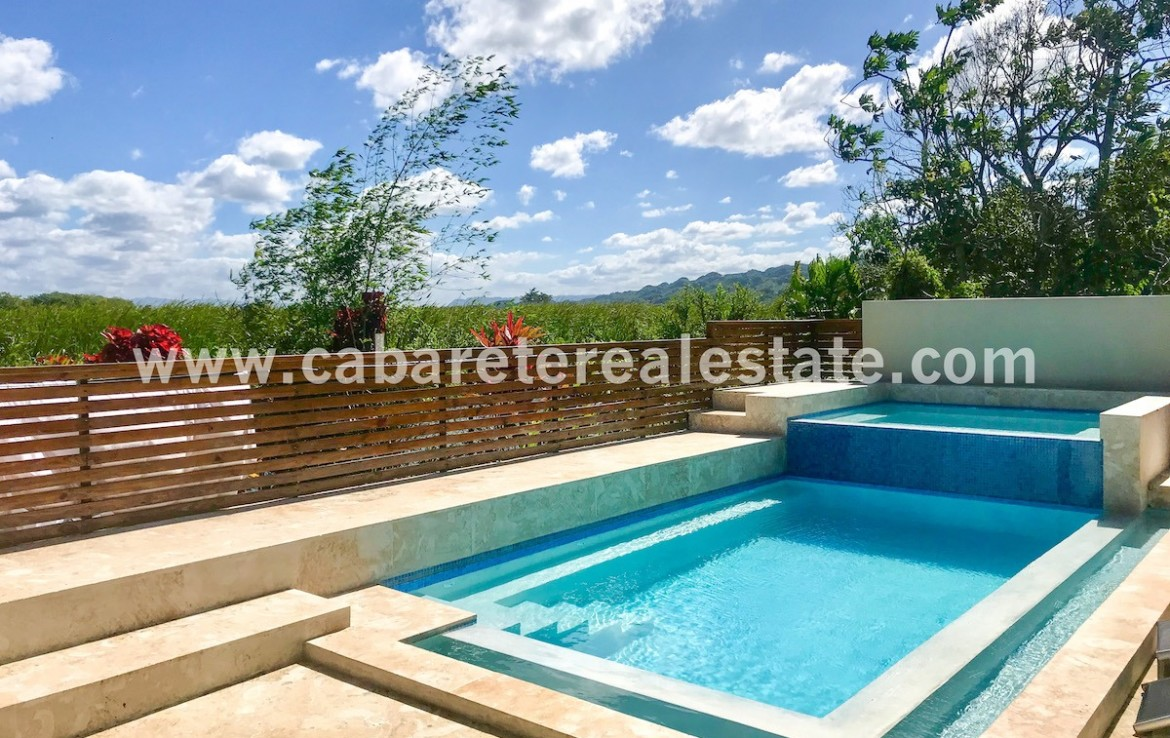 BedBreakfast pool area next to natural preserve and lagoon Cabarete Dominican Republic
