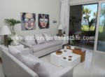 super modern livingroom with stunning gardenview in beachfront complex in cabarete