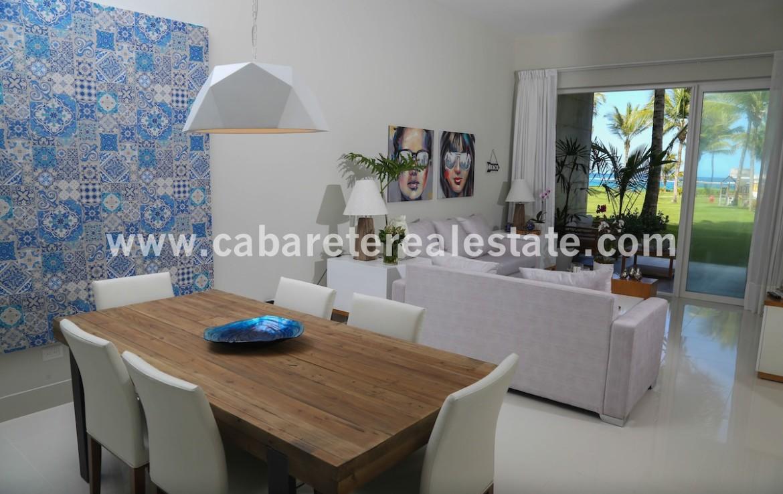 super modern livingroom with stunning gardenview in beachfront complex in cabarete