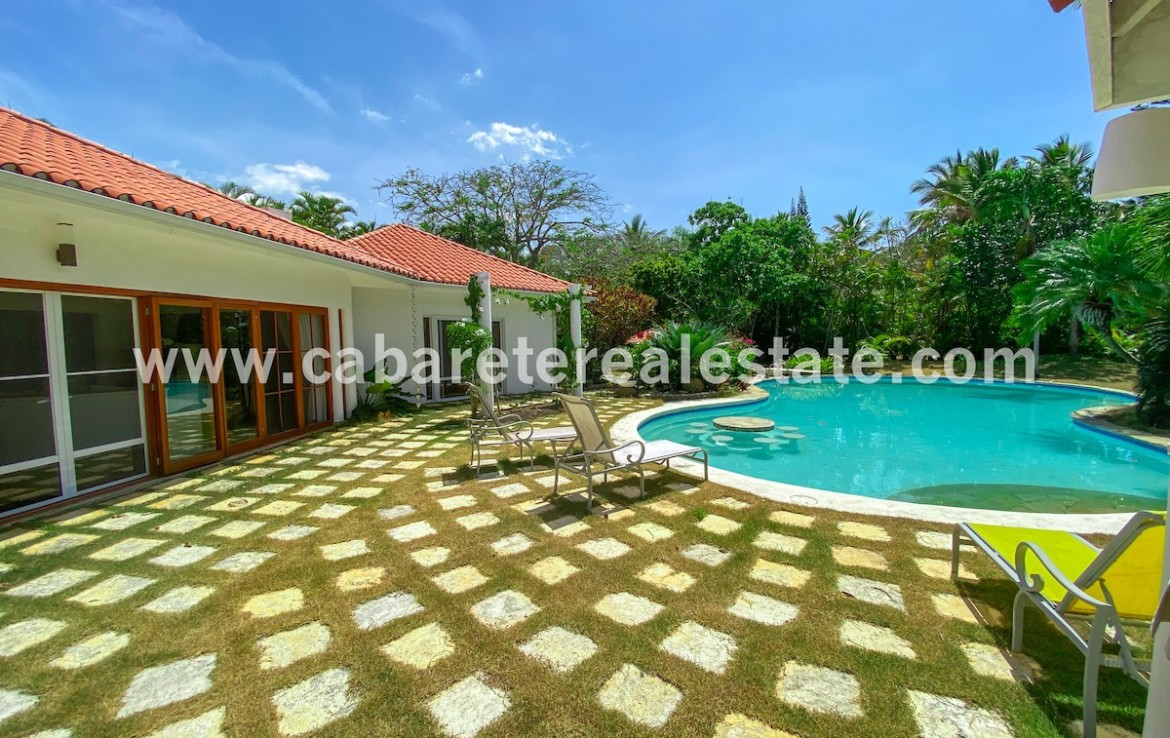 beautiful pool and garden view of this stunning villa in the best luxury gated community between sosua and cabarete