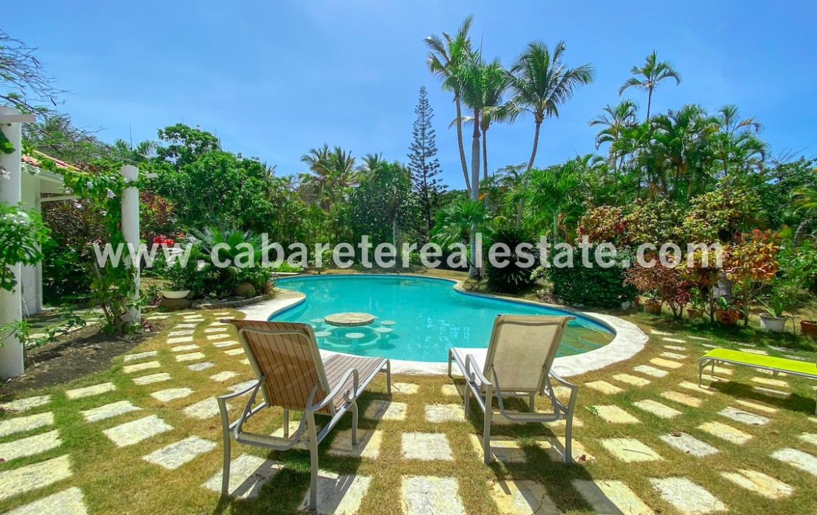 pool and garden view of this stunning villa in the best luxury gated community between sosua and cabarete