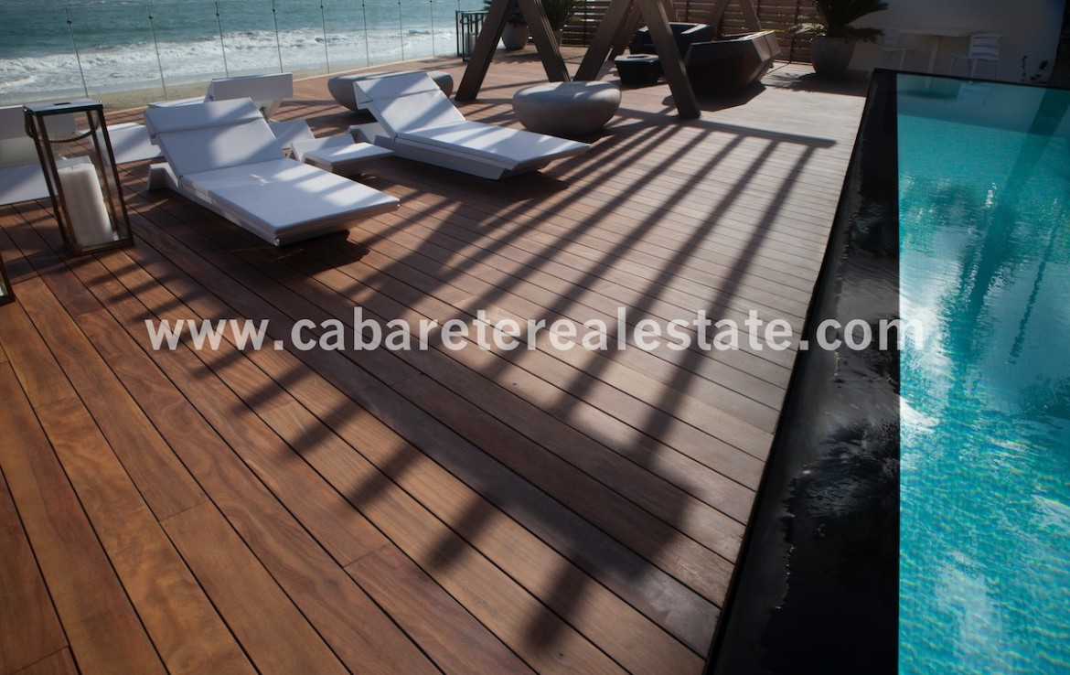 Beachfront pool with wooden deck beside your luxurious home on the beach Cabarete Real Estate 1