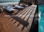Beachfront pool with wooden deck beside your luxurious home on the beach Cabarete Real Estate