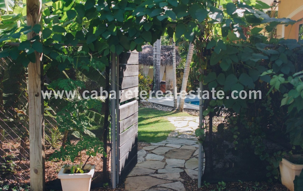 Gate to tropical garden in 3 bedroom home near the beach in Cabarete