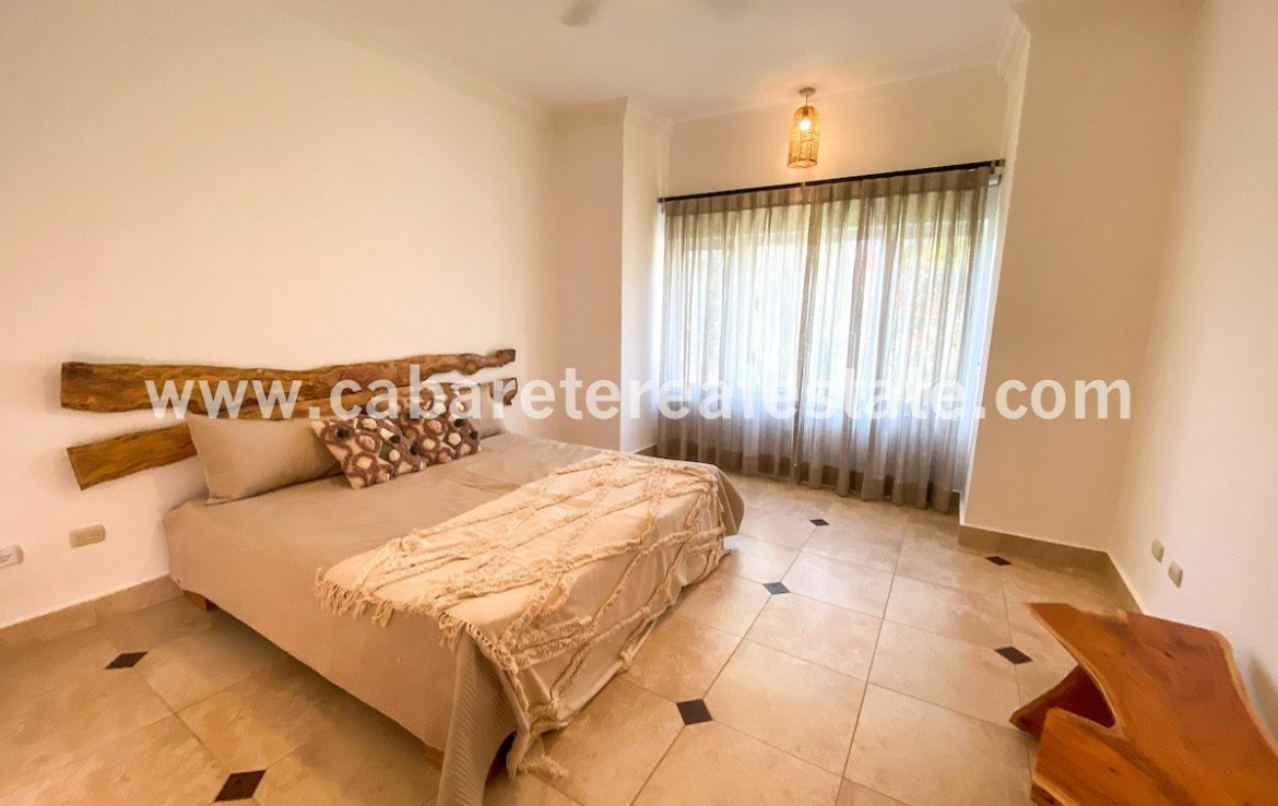 Luxurious guest bedroom in Beachside Condo Cabarete Gated community