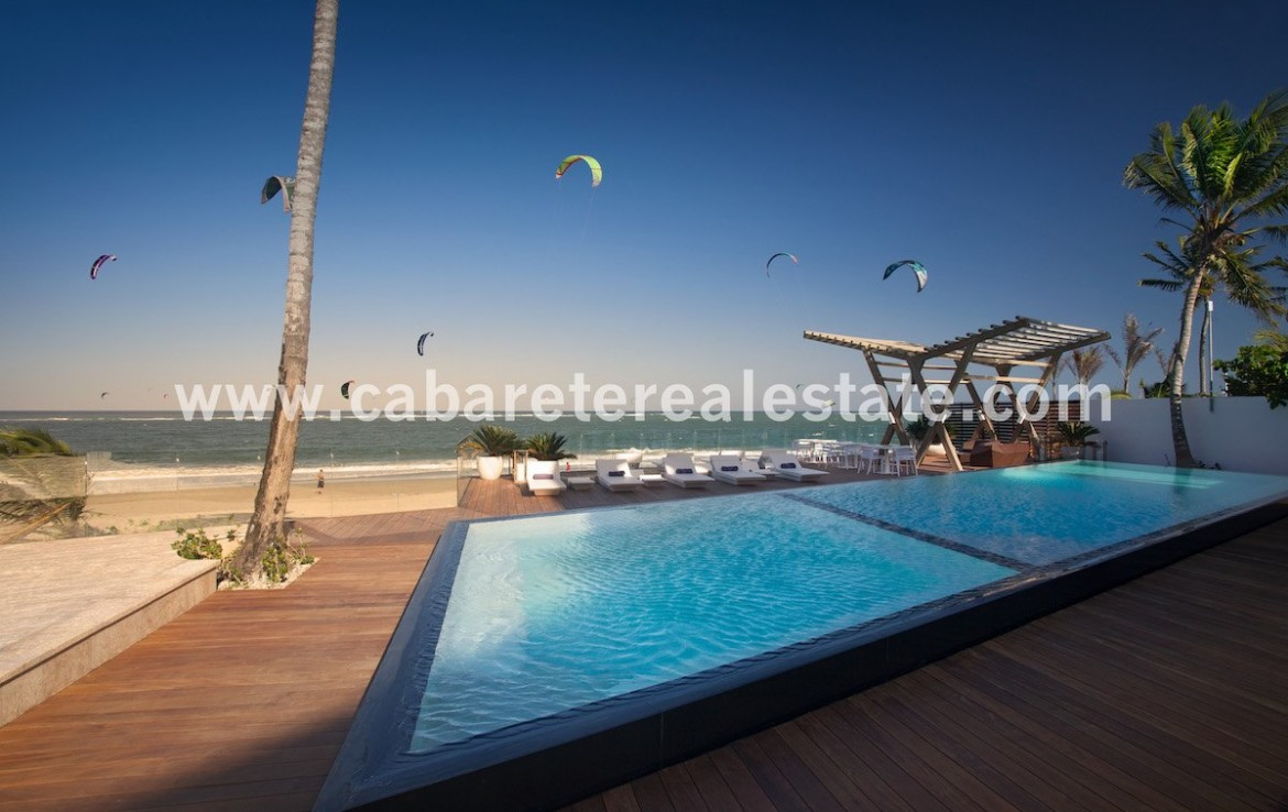 Ocean side swimming pool with wooden deck Cabarete Real Estate Beachfront apartment