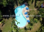 aerial shot of the stunning garden and huge pool at this luxury villa in the best gated beachfront community between sosua and cabarete