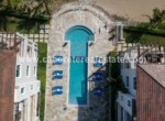 aerial shot over the huge pool in this luxury apartment in cabarete directly at the beach