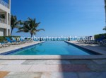 great pool directly next to the beach in this luxury apartment in cabarete