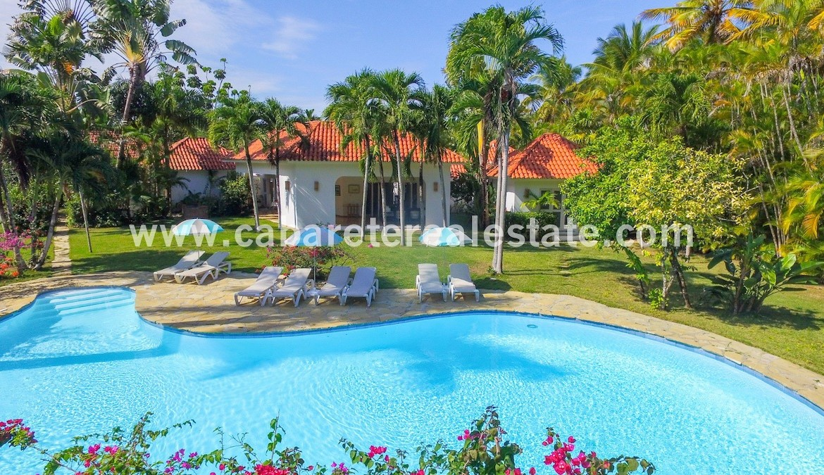 pool and garden view of this stunning villa in the best luxury gated community between sosua and cabarete 1 1