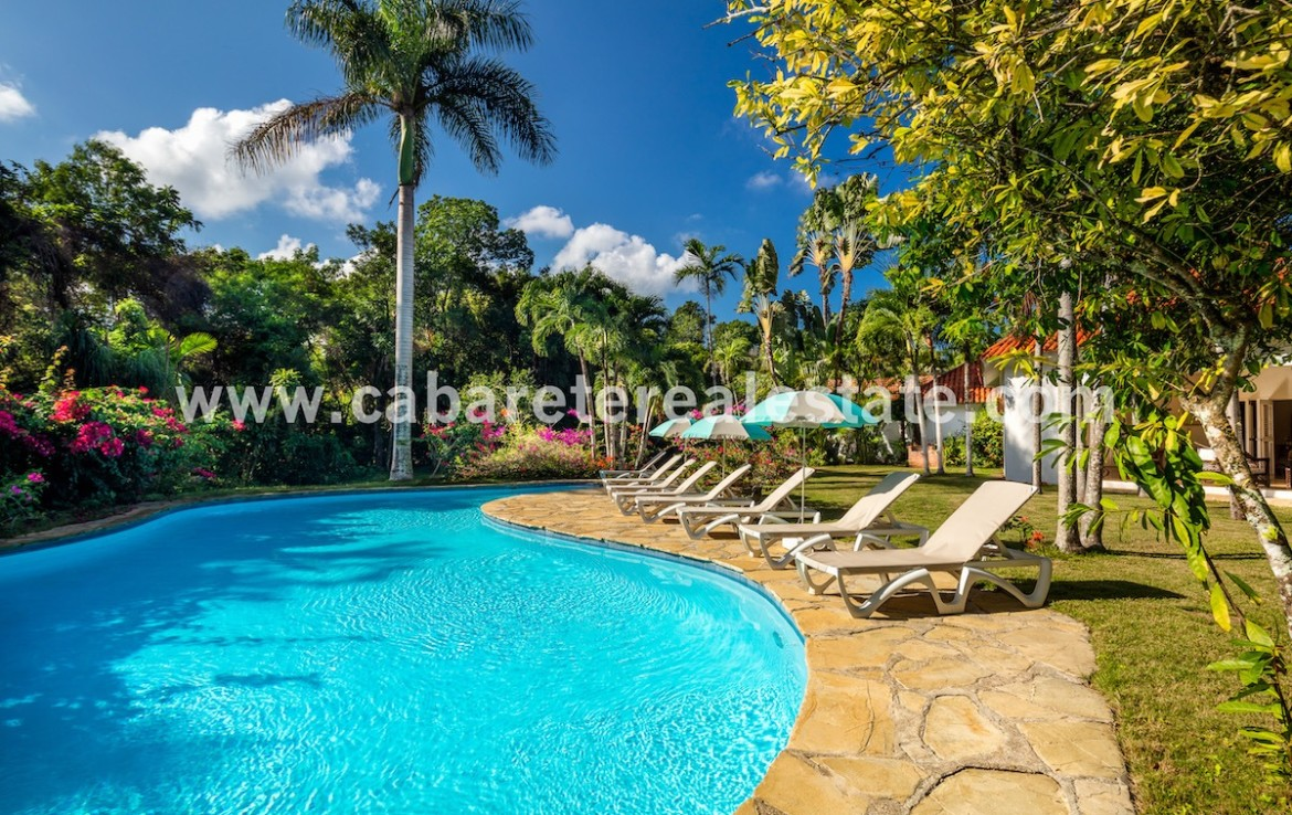 pool and garden view of this stunning villa in the best luxury gated community between sosua and cabarete 1 2