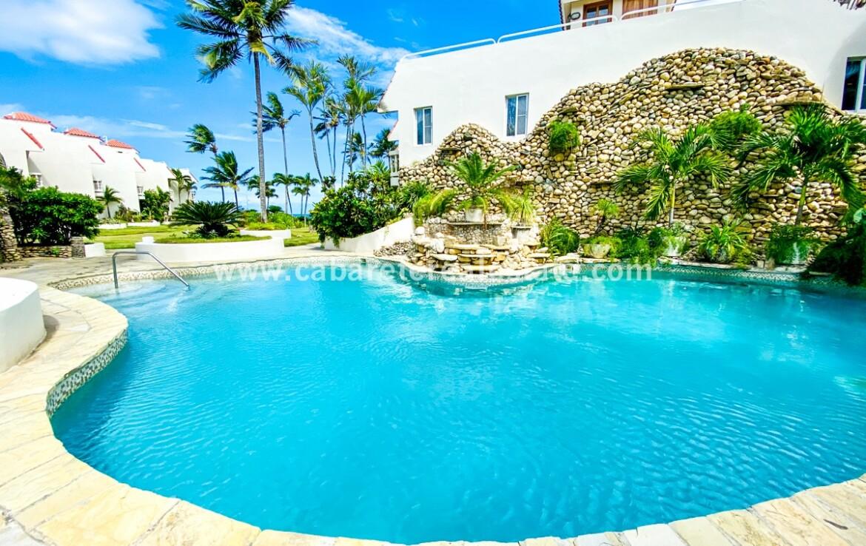 Pool and tropical garden at Beachfront villa Cabarete Real Estate Dominican Republic