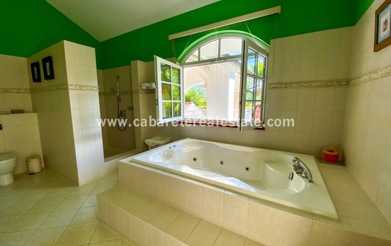 bath ensuite double sinks jacuzzi spa tub shower tile vanity tiled ocean dominican republic cabarete real estate