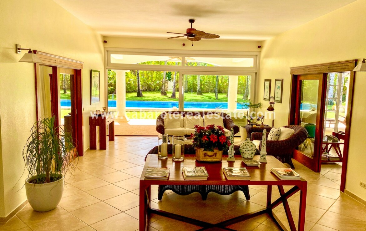 family room furnished furniture art fan tile carpet open doors pool living dining office cabarete dominican republic
