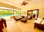 living grand room large open floorpan outdoors furnished furniture pool view seating cabarete dominican republic ceiling fan tile carpet