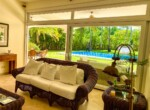 living room entertain guests furniture furnished pool view doors glass windows cabarete dominican republic villa family
