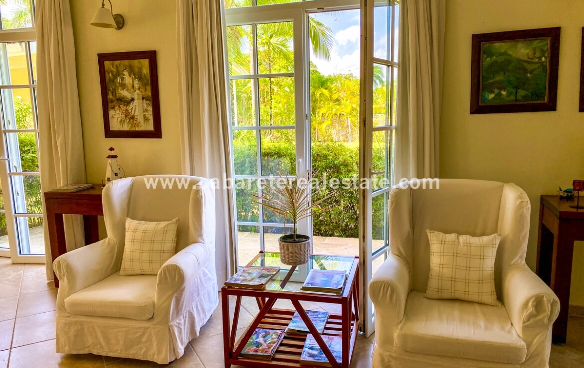 living room family guests entertain tv furniture furnished artwork french doors outside view cabarete dominican republic