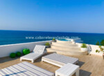 spacious rooftop chill area with jacuzzi and an amazing view over the beach and ocean at sosua