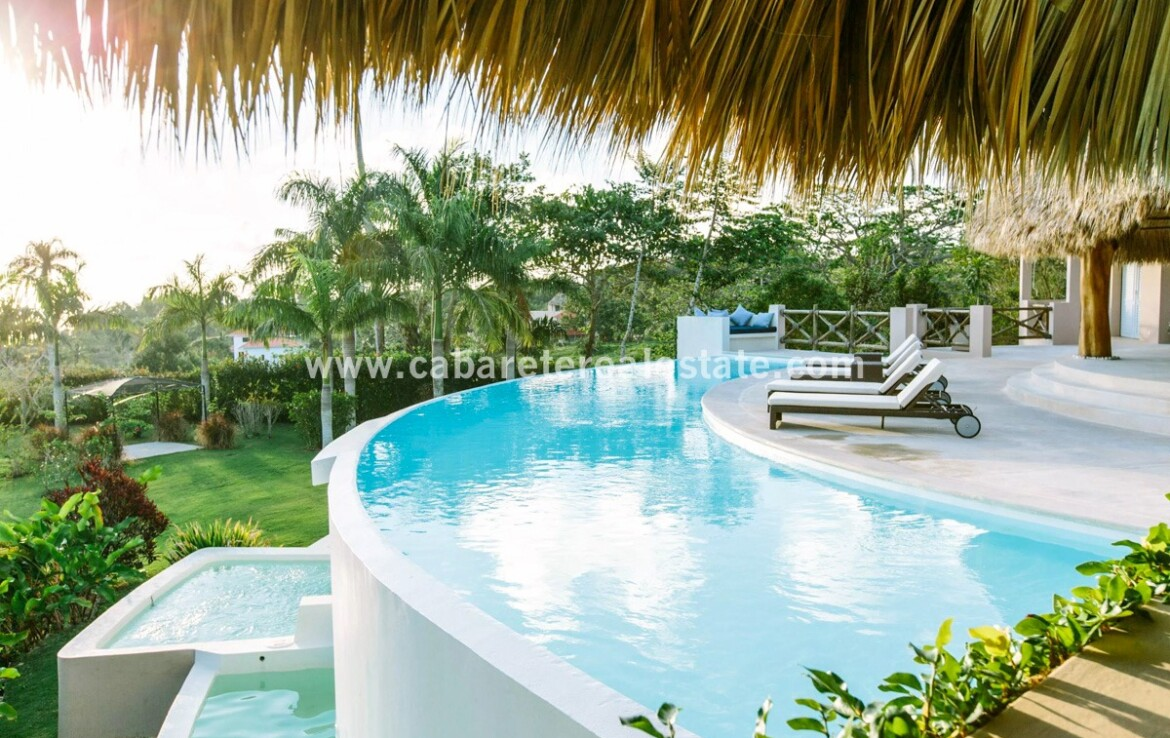 curved pool infinity ocean view palapa lounge outdoor cabrera dominican republic 1