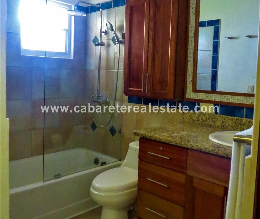 ensutie restroom bathroom vanity tub shower tile cabarete dominican republic oceanfront 1