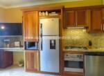kitchen kitchenette appliances tv desk office cabarete dominican republic oceanfront wood granite 1