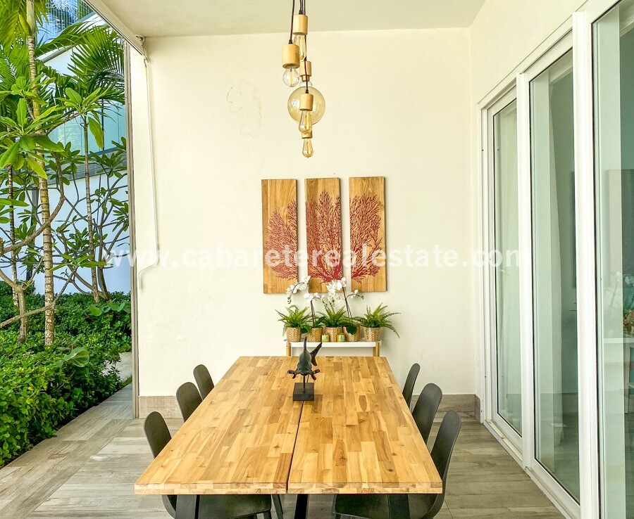 outdoor dining table seating view oceanside family cabarete oceanfront luxury aparthotel