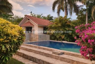 pool deck home garden landscape terrain trees Impeccable private cabarete villa