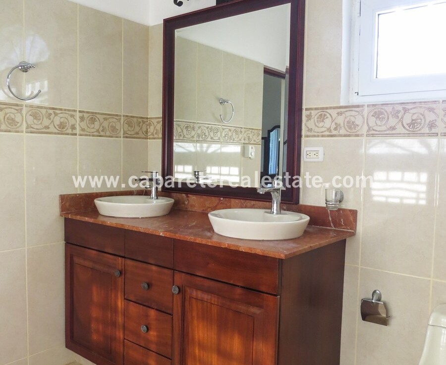 vanity sink bath bathroom tile wood clean spacious family villa encuentro