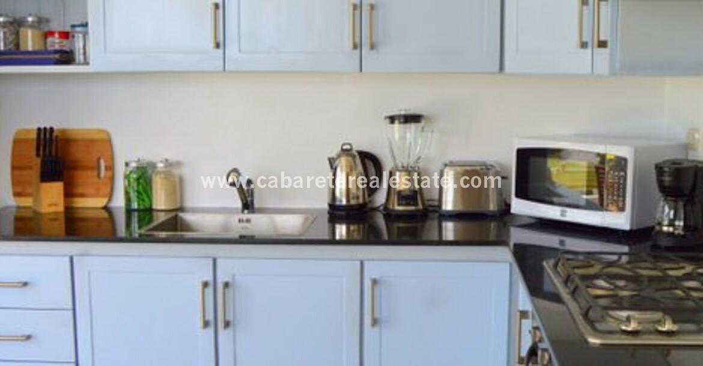 kitchen stove oven sink dominican republic ocean oceanfront comfortable contemporary Cabarete condo